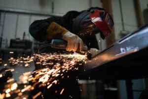 Man welding with gloves